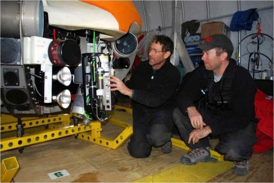Peter Doran and John Priscu (MCM) examine the science package on ENDURANCE