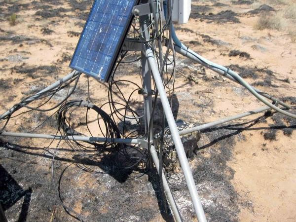 Fire damage to a solar panel, sensor cables and battery box