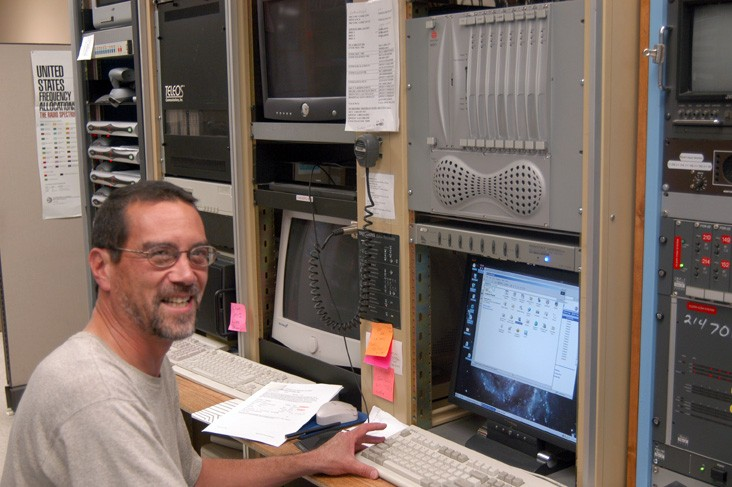 LNO Systems Analyst David Farris at the console of the Polycom Bridge.