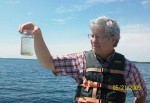 Stanley Dodson holding up a jar of Daphnia from Lake Mendota.