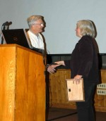 Barbara Benson receives an award from former LTER Chair, John Magnuson