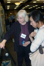 Barbara Benson explains details of her poster to an upcoming scientist