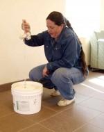 Citizen scientist LuAnn Marotte practices using a secchi disk