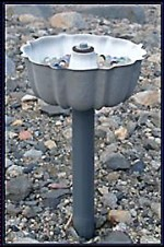 A bundt pan-passive aeolian sediment trap mounted 30 cm above the ground.