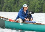 Gail Osherenko filming loons at a pond in Vermont. Photo: Orah Moore.