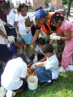 Baltimore Ecosystem Study's Quin Holifield studies soil with school children.